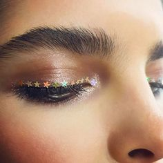 star sequins as eye liner + brushed up brows
