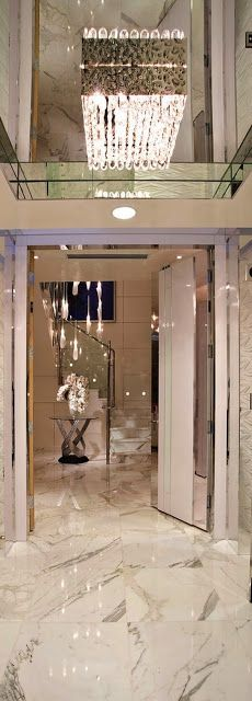 Luxury living.. Bling bling marble floors amazing chandelier
