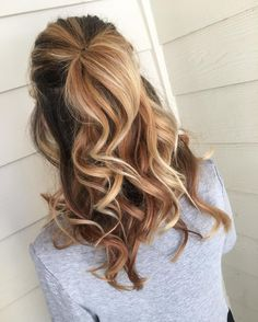 This stunning honey blonde balayage hair color by Aveda Artist Haley Watkins is perfect for spring and summer.