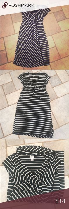 Motherhood Maternity Striped Dress Motherhood Maternity Dress in a Sz Small. Black and white striped with a tie at the back waist. Gathers at the chest for a cute and fun look. Made from rayon, polyester, and spandex. Made in Guatemala. Measurement- Chest: 14.5 in. Length: 35in. Shoulders: 14in. Motherhood Maternity Dresses Midi