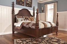 """The Flemingsburg Poster Bed from Ashley Furniture HomeStore (AFHS.com). Beautifully capturing the warm inviting elegance of grand traditional designed furniture, the """"Flemingsburg"""" bedroom collection features a lightly burnished dark brown finish flowing over the profiled frames and detailed moulding to create the bedroom of your dreams."""