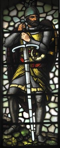 """Stained Glass Window #1 """"William Wallace"""" in the National Wallace Monument. [T]here are eleven significant stained glass windows. Perhaps the best-loved windows of all, and those most admired, are the four which are found in the 'Hall of Heroes', on the second floor. Striking because of their size, and their bold colours..these show Wallace himself, Robert the Bruce, and two warriors from the mediaeval period – an archer and a spearman. Stirling, Stirlingshire, Scotland."""