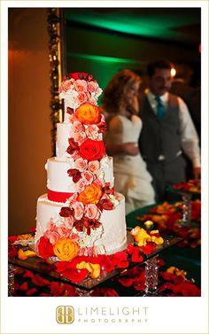 CASA MONICA, Florida, wedding cake, floral, flowers, petals, orange, pink, red, bride, groom, wedding photography, Limelight Photography, www.stepintothelimelight.com