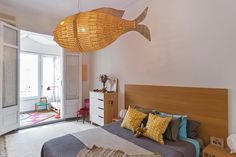 The big fish wicker lamp is one of her favorite things in her bedroom.