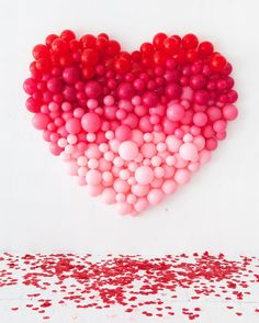 🌟Tante S!fr@ loves this📌🌟 Did you ever see our Giant Balloon Number DIY? So, we've taken that idea and created a giant ombre heart for Valentine's Day! Take a look… We've used a spectrum of red and pink balloons to easily cr Balloon Installation, Balloon Backdrop, Balloon Wall, Balloon Decorations, Diy Backdrop, Balloon Ideas, Heart Decorations, Balloon Background, Pink Balloons