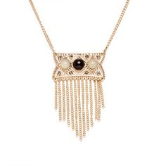 """Get fancy with the tassel plate Jordan Necklace. It features an ornate openwork plate adorned in onyx and mint cabachons complimented with smokey grey crystals. Sparkle with vintage style and take your look back to the good old days.  - Antiqued gold tone metal, crystal, resin - 22"""" long, 3"""" extender - Plate is 1"""" x 2"""" - Lobster clasp closure"""