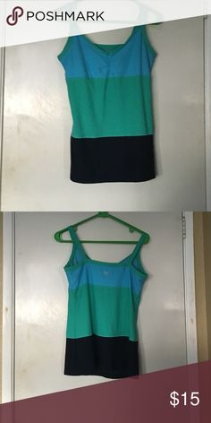 Workout Shirt I Workout!! Great condition shirt, no stains or rips, there is a built in bra, any questions just ask.  No Trades Xersion Tops Tank Tops