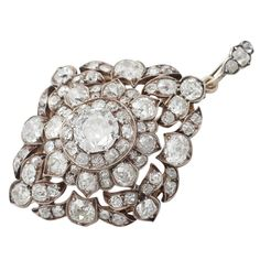 Victorian Diamond Silver Gold Cluster Pendant/Brooch | See more rare vintage Drop Necklaces at http://www.1stdibs.com/jewelry/necklaces/drop-necklaces