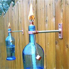WANT!!!  Blue Wine Bottle Tiki Torch  Outdoor by GreatBottlesofFire on Etsy