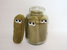 I have no idea why anyone would need these, but aren't these plush dill pickles adorable?