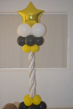 Yellow and Black Balloon Column with Gold Star