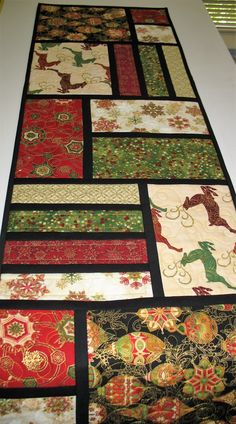 Christmas Table Runner. reindeer, Christmas ornaments. quilted  from Kaufman…