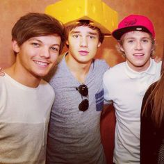 I love this picture. They all look so cute! This was before Niall did his hair up and it looks cute and Liam is wearing a cheese hat and Louis is just standing there looking adorable as always.....this pic is perfect.