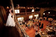 Here our bride tosses her bouquet to the anxious guests below.  This historic site is a great Lake Tahoe wedding venue. http://lakefrontwedding.com/lake-tahoe-wedding-venues/lake-tahoe-wedding-historic-lakefront-estate/