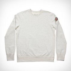 ACE HOTEL X REIGNING CHAMP SWEATSHIRT // $120. Made in Canada from durably soft, mid-weight twill terry. In heather cream with vintage rib collar, cuff and waistband, in-set sleeves and flat-lock seam stitching. With an exclusive co-branded tag and embroidered felt patch with an iconic city logo for each of the four Aces — Seattle, Portland, New York and Palm Springs. Available in sizes XS, S, M, L and XL. See our online shop for availabilities and precise dimensions.