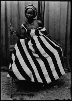 A photograph by Seydou Keita, recognized as the father of African photography and one of the greatest photographers of the 20th century.