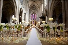 whoa! Loving the idea of the placement of flowers and candles hides the chairs and would make any location warm.