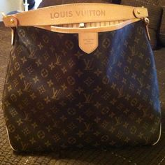 Louis Vuitton Delightful MM. This is my favorite bag.  It's functional, practical, and absolutely beautiful!