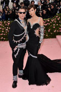Bella Hadid in Moschino by Jeremy Scott wearing Lorraine Schwartz jewelry and Jeremy Scott