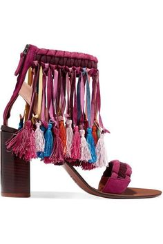 Chloé's sandals are made from braided burgundy and plum suede knotted with rainbow-bright tassels that envelop your foot. This block-heeled pair has a discreet beige leather strap so they fit securely. Embrace the bohemian feel with floaty dresses.