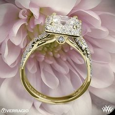 This Diamond Engagement Ring is from the Verragio Couture Collection. It  features 0.45ctw of Round Brilliant Diamond Melee (F/G VS) that enhance the princess, radiant or a square diamond center of your choice. The width tapers from 5.3mm at the top down to 2.5mm at the bottom. Select your diamond from our extensive online diamond inventory. Please allow 4 weeks for completion. Platinum rings carry a 5 week turnaround time. If you have any questions regarding this item then please contact…