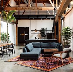 Wooden beams Low couch Bright rug