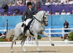 Juan Manuel Munoz Diaz of Spain riding Fuego performs during the equestrian Dressage Individual Grand Prix Freestyle at the London 2012 Olympic Games in Greenwich Park.