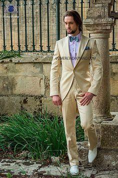 Beige short-tailed suit in 'Alta Moda Solbiati' cotton satin fabric, with peak lapel, single corozo button closure and single vent at back, style 1039 Ottavio Nuccio Gala, 2015 Fashion Collection.