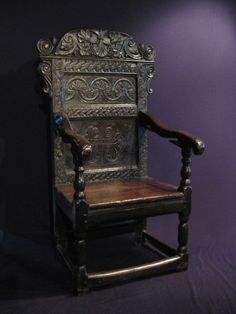 """A LARGE AND HANDSOME EARLY 17TH CENTURY CARVED OAK WAINSCOT ARMCHAIR. CIRCA 1640.    PROBABLY WEST COUNTRY. PROVENANCE- THE ROUS LENCH COLLECTION. REPAIRS TO FEET.  28.5"""" WIDE X 50.5"""" HIGH X 22"""" DEEP."""