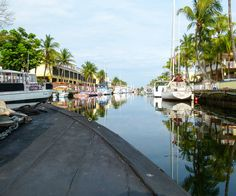 The African Queen cruises down a Key Largo canal in the Florida Keys.