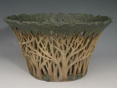 The three dimensional trees on this pot are what caught my eye and started my pottery addiction. The fact that they can get the clay to show that much detail is amazing! They go through the whole process on the site: http://www.silverkiln.com