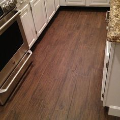 Matching grout.  Porcelain Plank Wood Look Tile.... No fading or denting like wood... no need to sand them down in a few years... The answer to kitchen, bathroom and laundry floors.