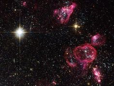Pink bubbles of glowing gas punctuate the irregularly shaped dwarf galaxy Holmberg II in a newly released picture from the NASA/ESA Hubble Space Telescope. The bubbles formed when very massive stars died as supernovae, blowing out and heating material with violent shock waves.