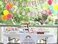 Adorable Rainbow party... the cake is amazing, as well.