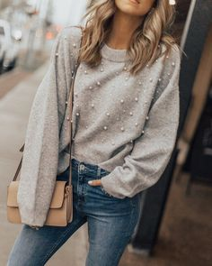 pearl sweater, blue jeans, neutral bag
