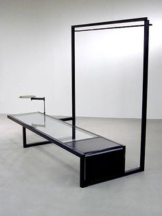 Low bench with hanging rail and display armature by Face Design + Fabrication