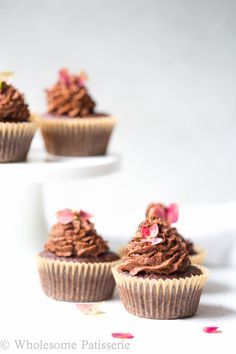 Quick gluten free cupcakes topped with vegan and sugar free chocolate coconut frosting! | wholesomepatisserie.com