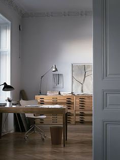 study / office / light wood flat files / wood desk / parquetry floor / wood + white + grey