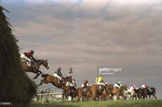 Horses leap over Beechers Brook during the Grand National at Aintree racecourse, Liverpool, England. Rough Quest won the race. \ Mandatory Credit: Ross Kinnaird/Allsport