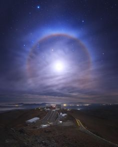 Lunar halo above La Silla observatory in Atacama, Chile :) During one of the nights we were lucky to see such an interesting phenomenon as 22° Halo around the moon. The clouds were flying all over the sky and the Moon was quite spectacular indeed ! You can also see setting Orion constellation, as well as Sirius - the brightest star on the sky (in the upper left). I hope you'll enjoy the view