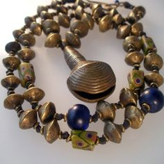 The Curious Bead |  19th century Nigerian bass beads and bell are combined with old African Trade Beads