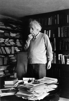 German born physicist who formulated the theories of relativity, Albert Einstein - ponders a problem in his paper-filled study in Princeton, New Jersey. A Nobel prize-winner for Physics in Original Publication: In black and white book Theory Of Relativity, E Mc2, Old Photography, Photography Gallery, Physicist, Belle Photo, New Jersey, South Beach, Black And White Photography