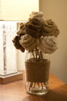 Burlap roses in a recycled sauce jar, these could be so sweet & could be used as favors as well!!