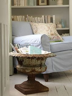 Lined with a remnant of burlap, this antique urn makes a stylish magazine holder, adding character and charm to any home library.