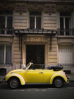vintage yellow volkswagon bug