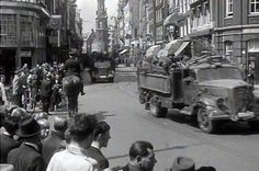 May 1940. A convoy of vehicles of the German Wehrmacht occupation at the Reguliersbreestraat and Rembrandtplein in Amsterdam. In the background the Munttoren and on the left cafeteria Heck's Popularis. After the capitulation of the Dutch armed forces on May 15, 1940, German troops occupied The Netherlands and Amsterdam. #amsterdam #worldwar2 #Reguliersbreestaat #Rembrandtplein