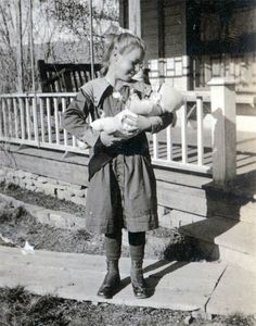 Vintage photo of a little girl with her doll.