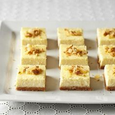 Eggnog Cheesecake Bars: A spiced graham cracker crust and bourbon-infused egg nog filling give these simple bars a delicious holiday twist. Recipe: http://www.midwestliving.com/recipe/eggnog-cheesecake-bars/
