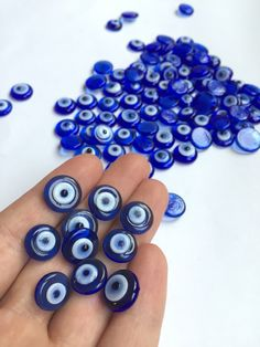 Dark blue  evil eye flat beads 10 mm - Glass evil eye beads - 100 pcs - Turkish evil eye beads - Nazar boncuk - Wholesale beads by Evileyeuniquegifts on Etsy https://www.etsy.com/listing/269199946/dark-blue-evil-eye-flat-beads-10-mm