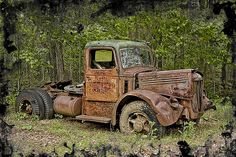 Once he was the king of the road. Mack was his name. He pulled thousands of pounds of loads in gleaming trailers. Traveled every road in America, over mountains, valleys...he now sits rusting away in a grove somewhere, a forgotten road warrior...